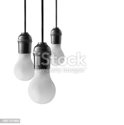 637573406istockphoto Hanging light bulbs 595154966