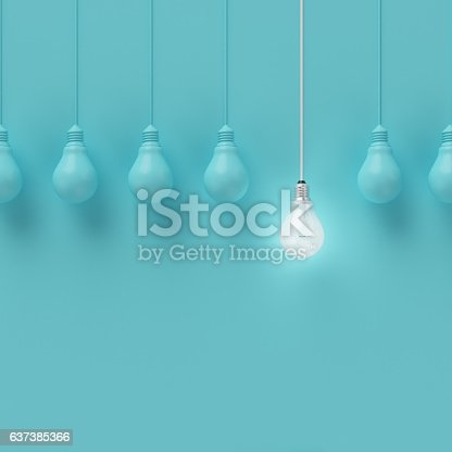 istock Hanging light bulbs with glowing one different idea. 637385366