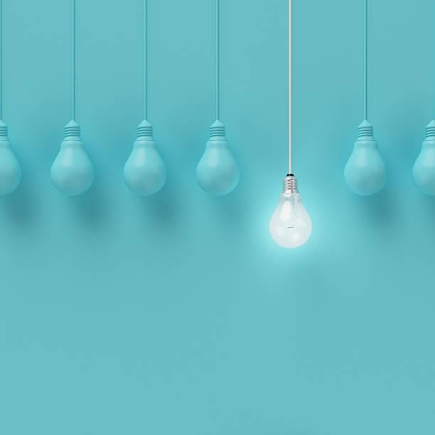 hanging light bulbs with glowing one different idea. - 一個物體 個照片及圖片檔