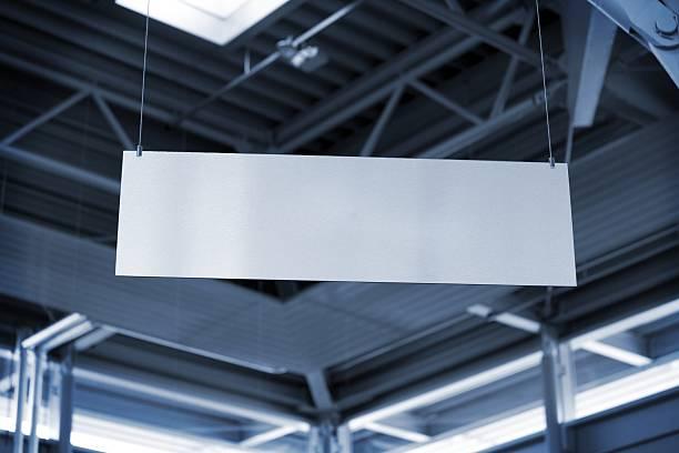 hanging metal billboard in business room stock photo