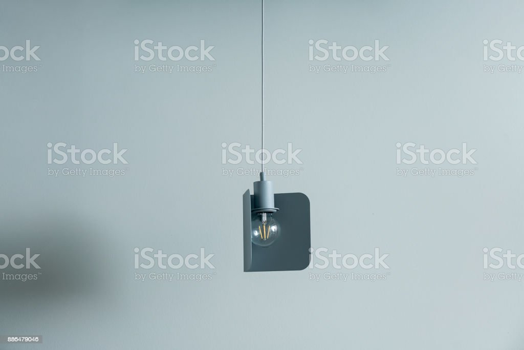 Hanging metal gray-blue edison lamp stock photo