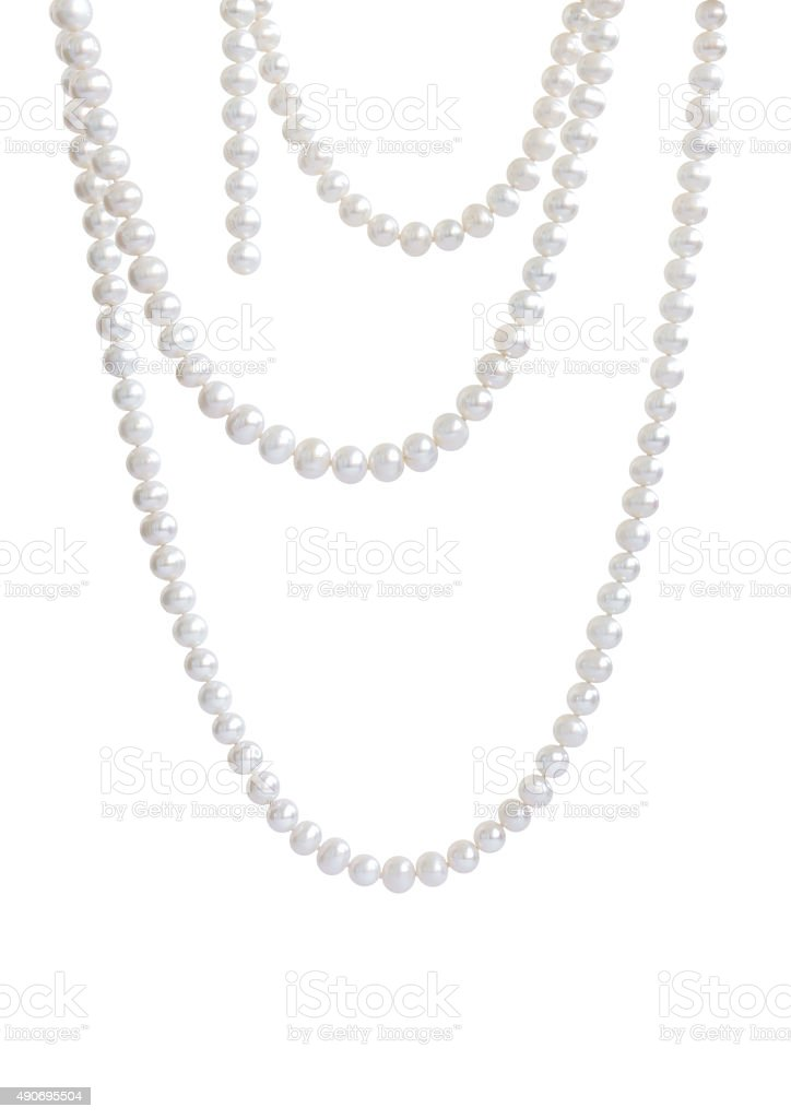 Hanging natural pearl necklace, isolated on white stock photo