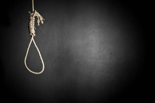 A hanging noose rope on black background stock photo