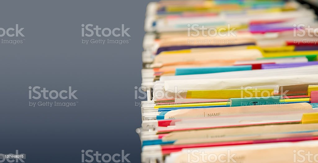 Hanging old file folders with neutral copy space stock photo