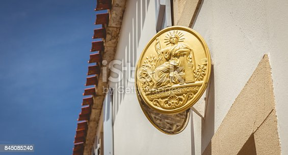 istock hanging on the wall of a house, a notary's plate 845085240