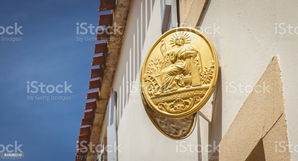 hanging on the wall of a house, a notary's plate stock photo