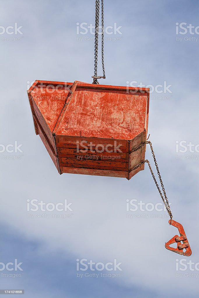 Hanging orange rubble container royalty-free stock photo