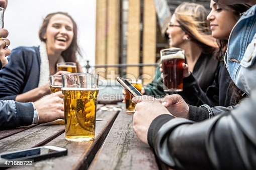 istock Hanging out with a fresh beer in a London Pub 471688722
