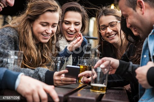 istock Hanging out with a fresh beer in a London Pub 475371226