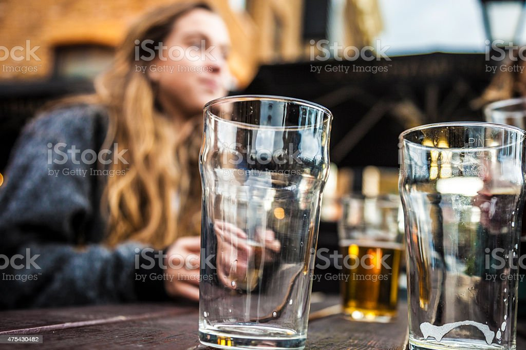 Hanging out with a fresh beer in a London Pub stock photo