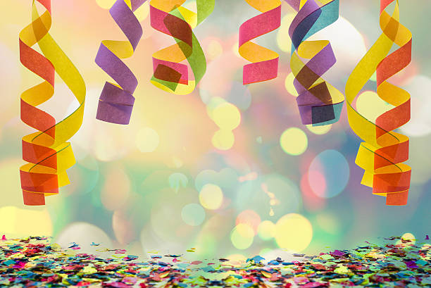 hanging paper streamer and confetti stock photo