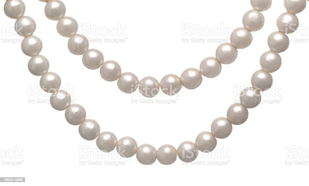 Hanging Pearl necklace over a white background isolated - Royalty-free Abstract Stock Photo