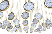 An array of intricate gold antique pocket watches hanging by their chains on an isolated white studio background - 3D render