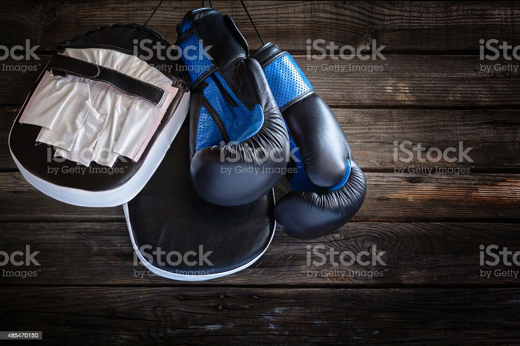 Hanging  punching mitts and boxing gloves stock photo