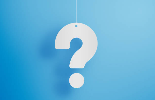 Hanging question mark on blue background stock photo stock photo