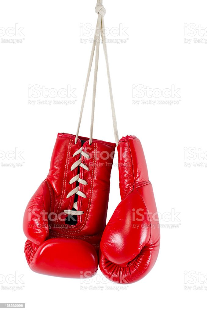 Hanging red boxing gloves on white background stock photo