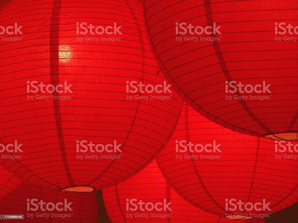 Hanging red paper lanterns glowing stock photo