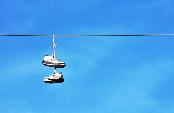 hanging schuh - kabelschuhe stock-fotos und bilder