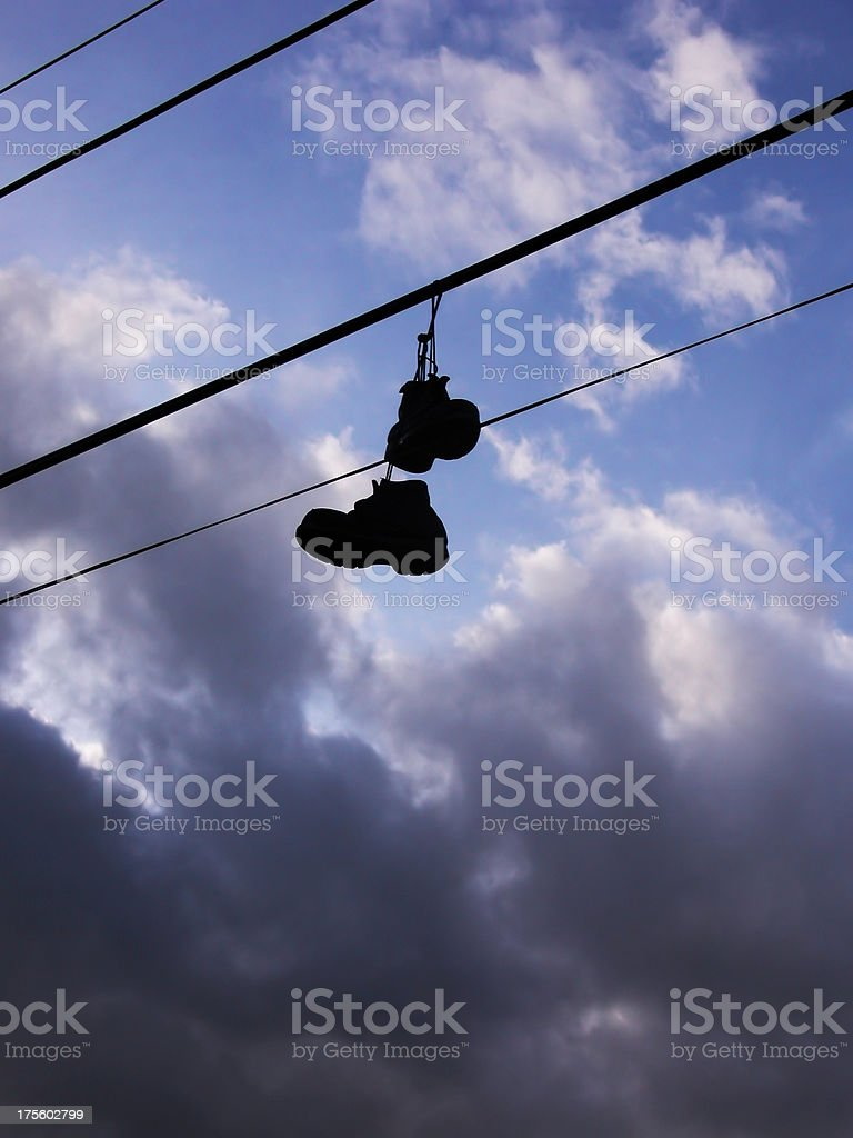 hanging shoes royalty-free stock photo