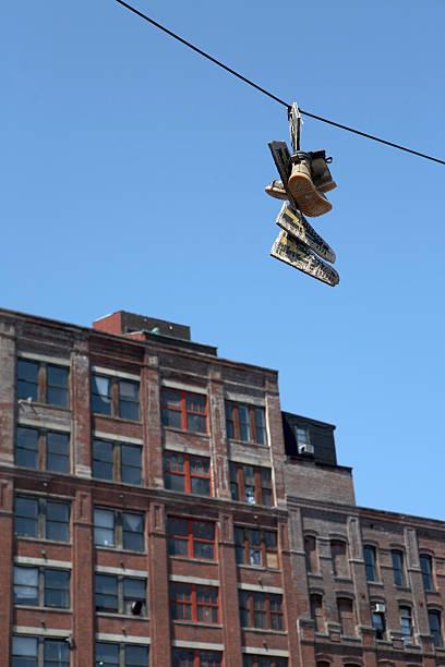 hanging schuh mit souls - kabelschuhe stock-fotos und bilder