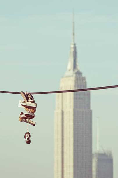 hanging sneaker nyc - kabelschuhe stock-fotos und bilder