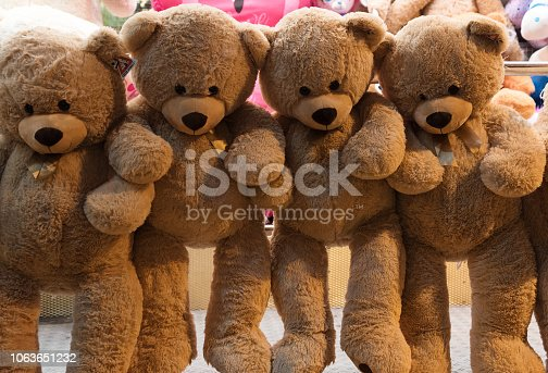 hanging teddy bears, prices of a lottery stall at the funfair autumn market