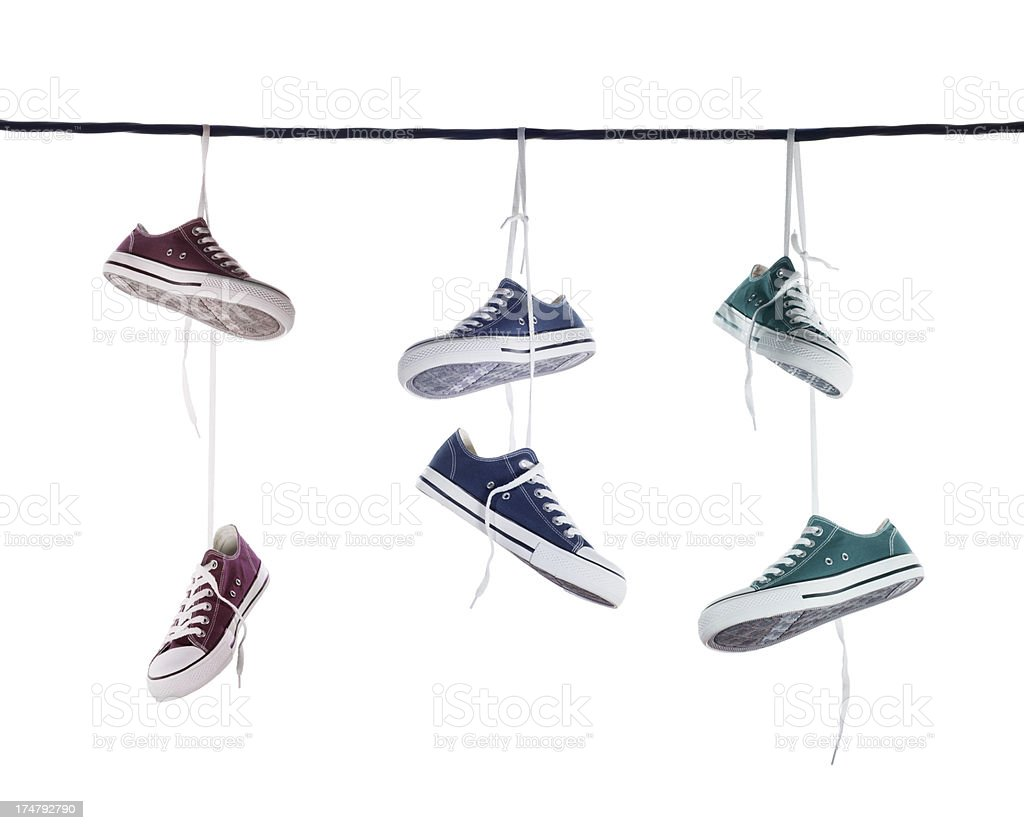 Hanging Tennis Shoes On A Telephone Wire Stock Photo