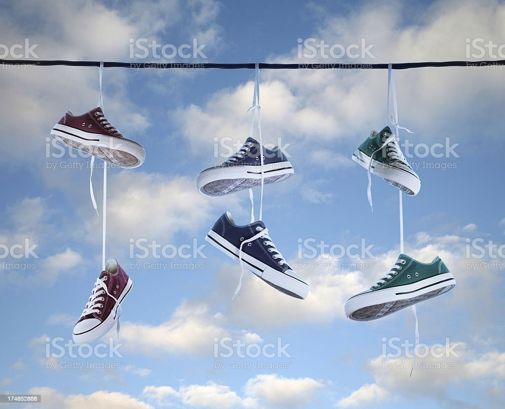 Hanging Tennis Shoes On A Telephone Wire Stock Photo & More Pictures ...