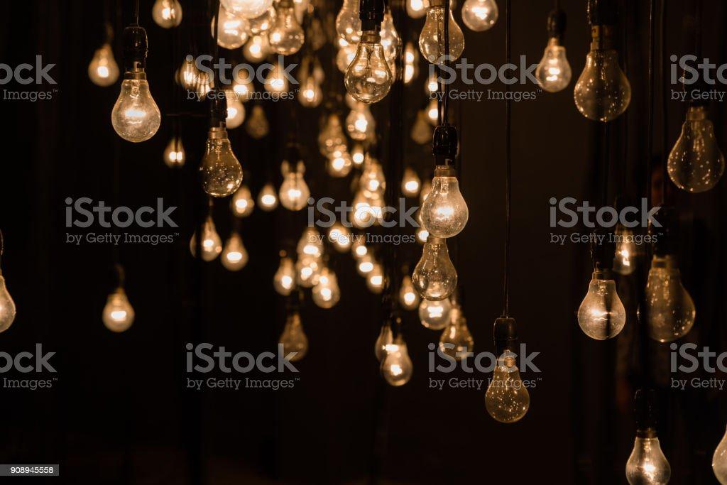 Hanging tungsten lamp bulbs stock photo