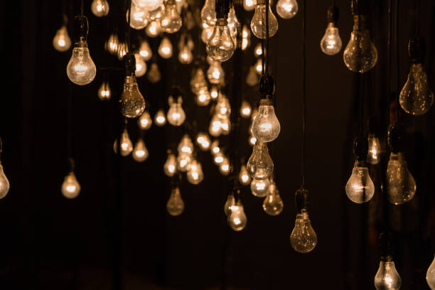 hanging tungsten lamp bulbs - low lighting stock photos and pictures