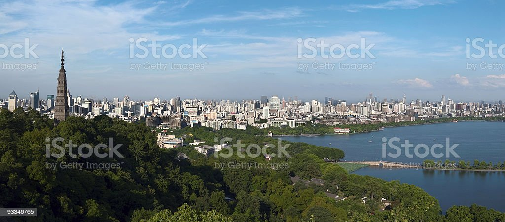 Hangzhou West Lake over a cityscape and trees view stock photo