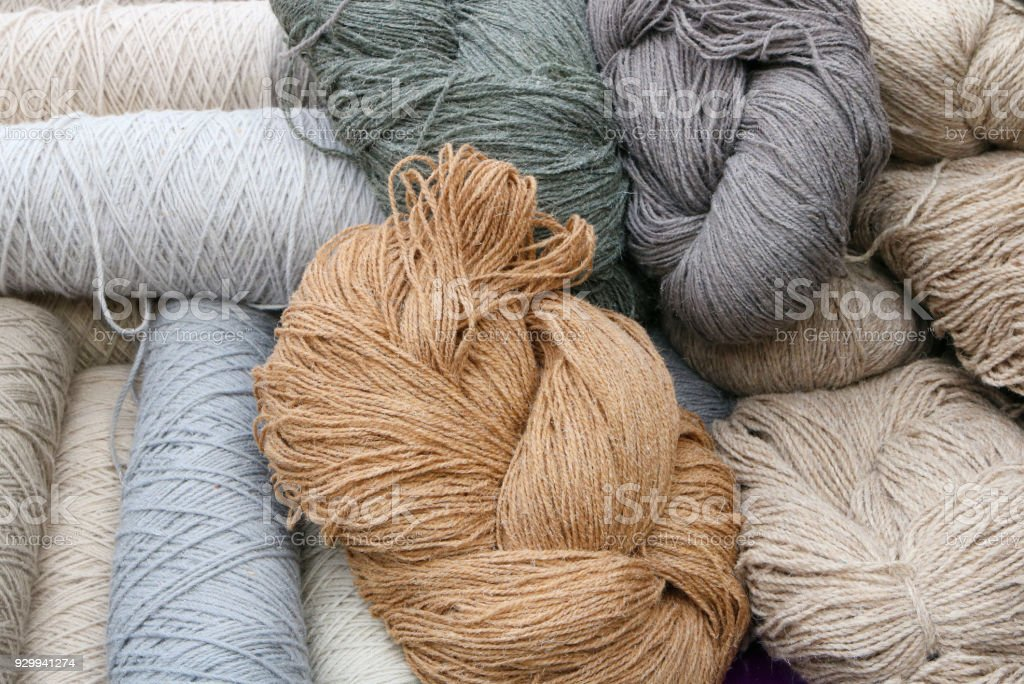 Hanks of thread from coarse sheep wool for knitting warm sweaters stock photo