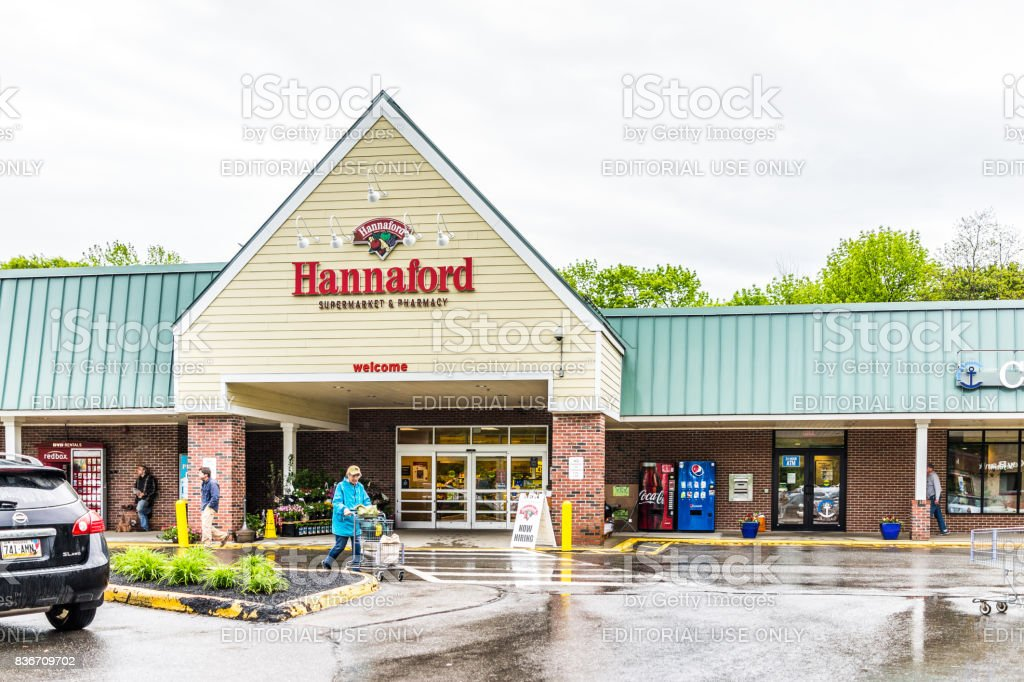 Hannaford supermarket in Maine city with sign and people shopping stock photo
