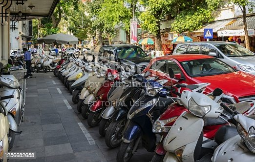 Hanoi, Vietnam, November 24, 2014: Motorcycles are the most common means of transportation in the Vietnamese capital. View of a street in the downtown of Hanoi.