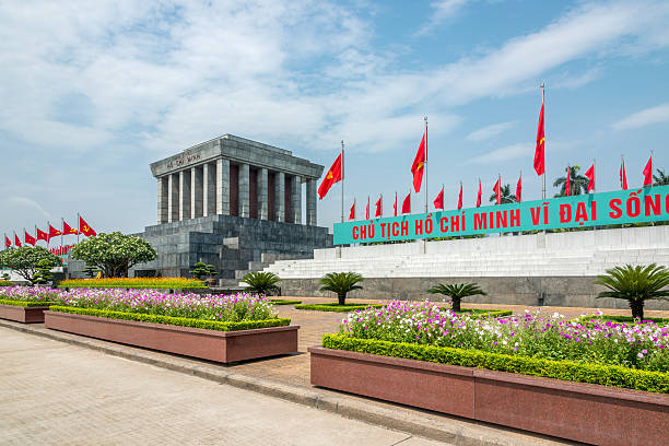 Hanoi Ho Chi Minh Mausoleum, Vietnam Promenade with vietnamese flags in a row at the mausoleum of  Ho Chi Minh in Hanoi, North Vietnam, South East Asia. hanoi stock pictures, royalty-free photos & images