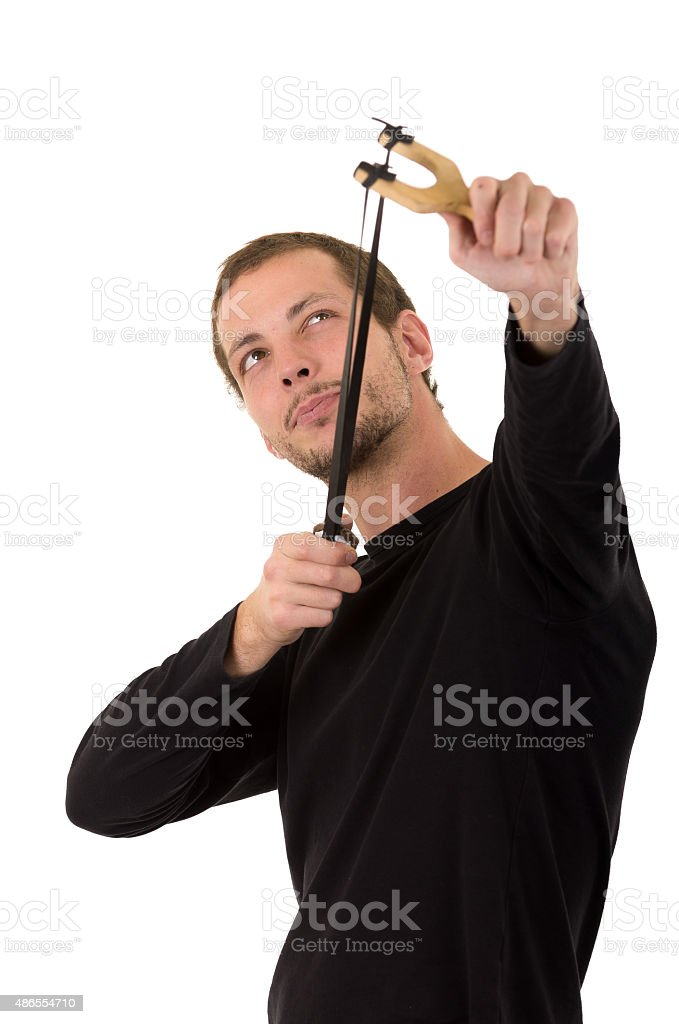 Hansome man concentrated aiming a slingshot isolated over white background stock photo