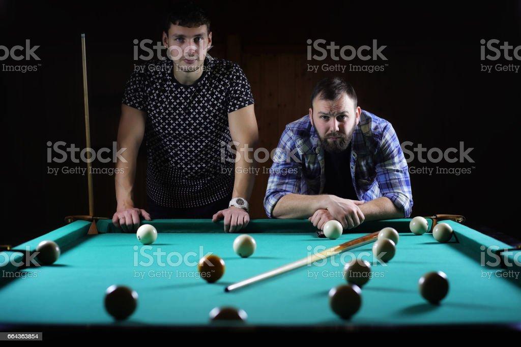 hansome man playing billiards alone stock photo