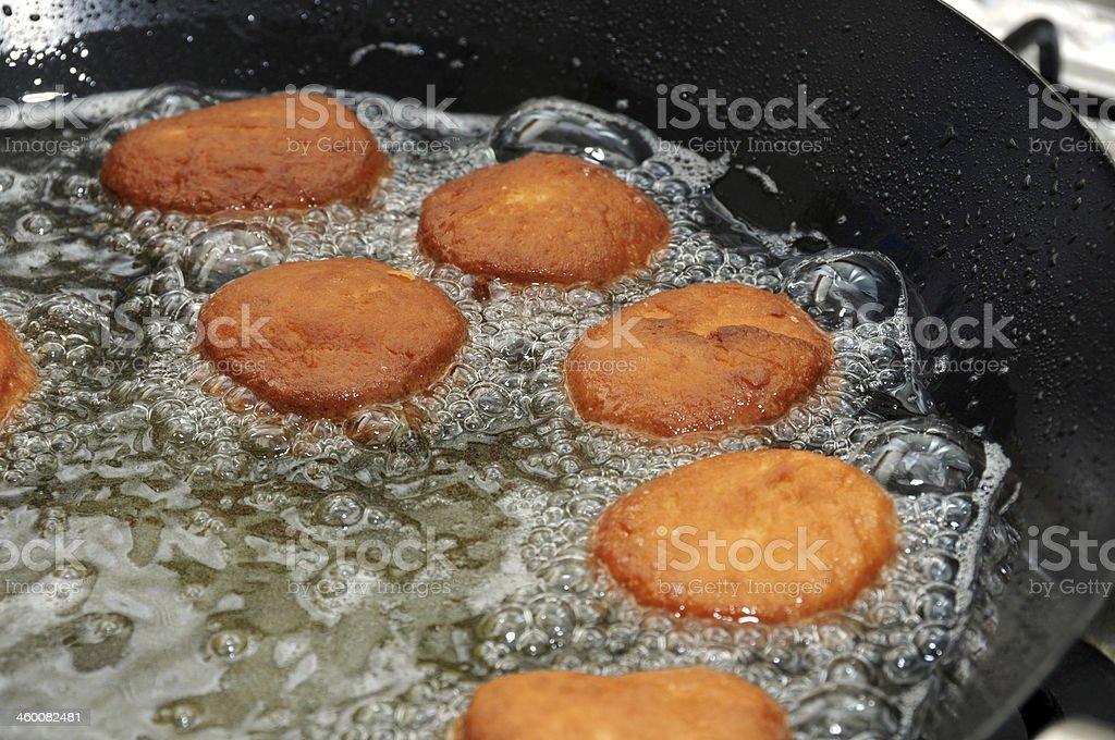 Hanukah doughnuts frying stock photo