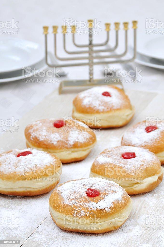 Hanukah doughnuts, sufganiya and menorah stock photo