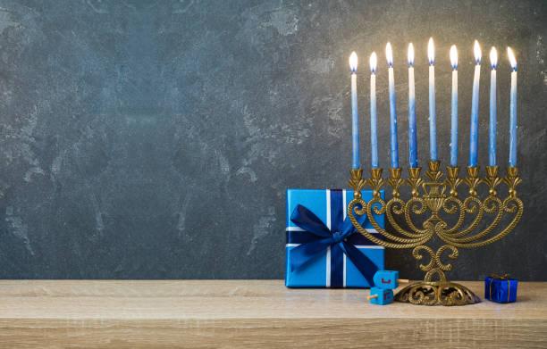 hanukkah celebration with menorah - hanukkah stock pictures, royalty-free photos & images