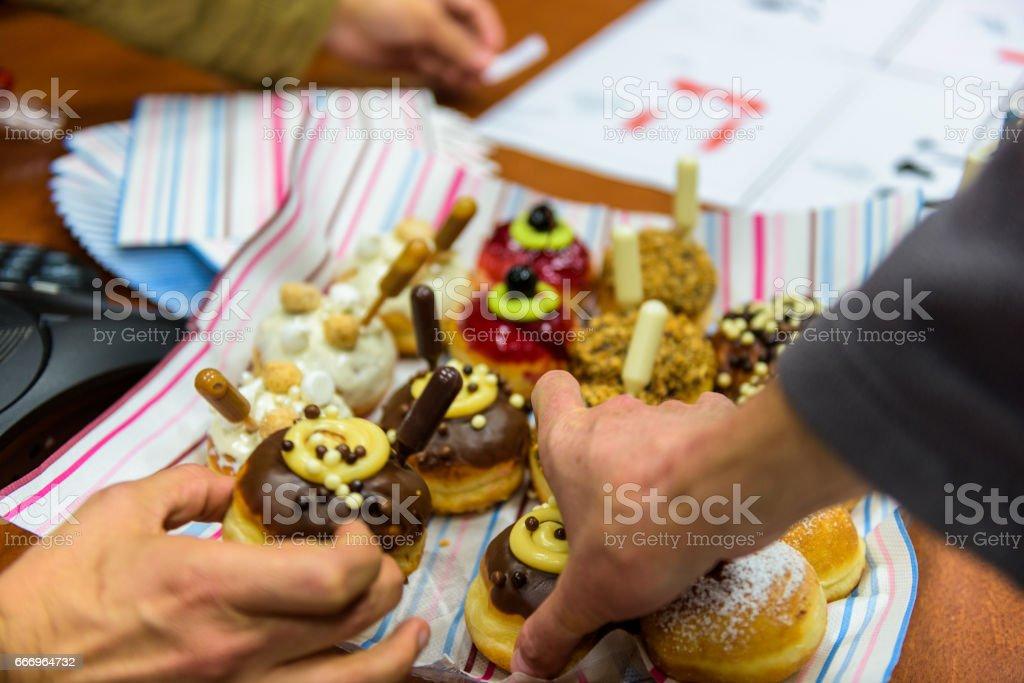 Hanukkah celebration with various decorated doughnuts (Sufganiyah) stock photo