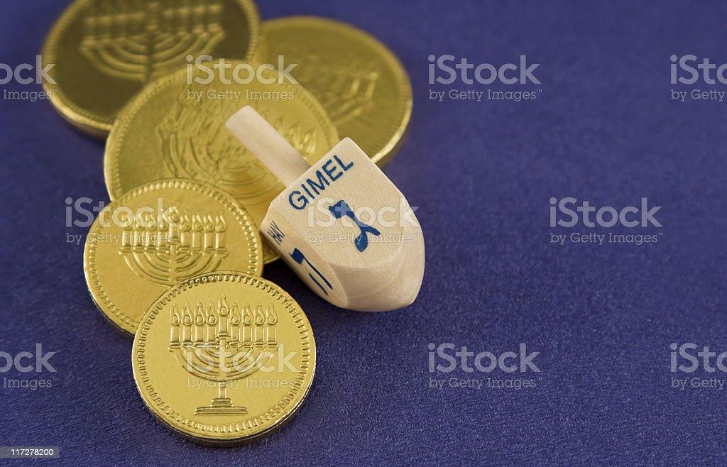 Hanukkah dreidel and gelt stock photo