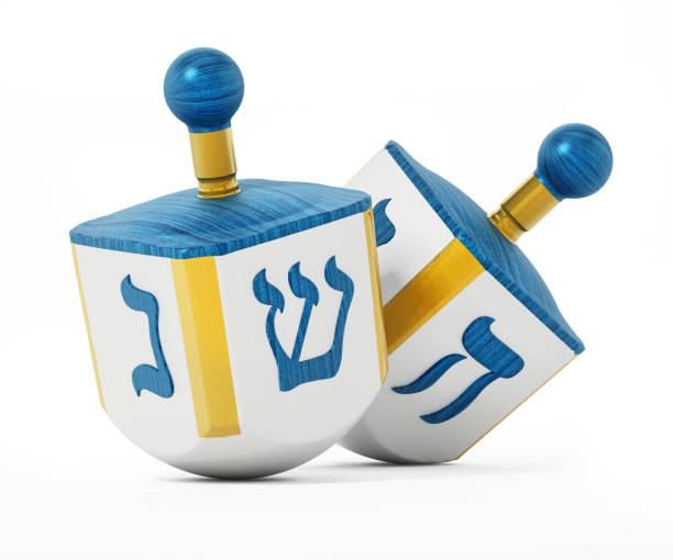 hanukkah dreidels isolated on white - hanukkah stock pictures, royalty-free photos & images