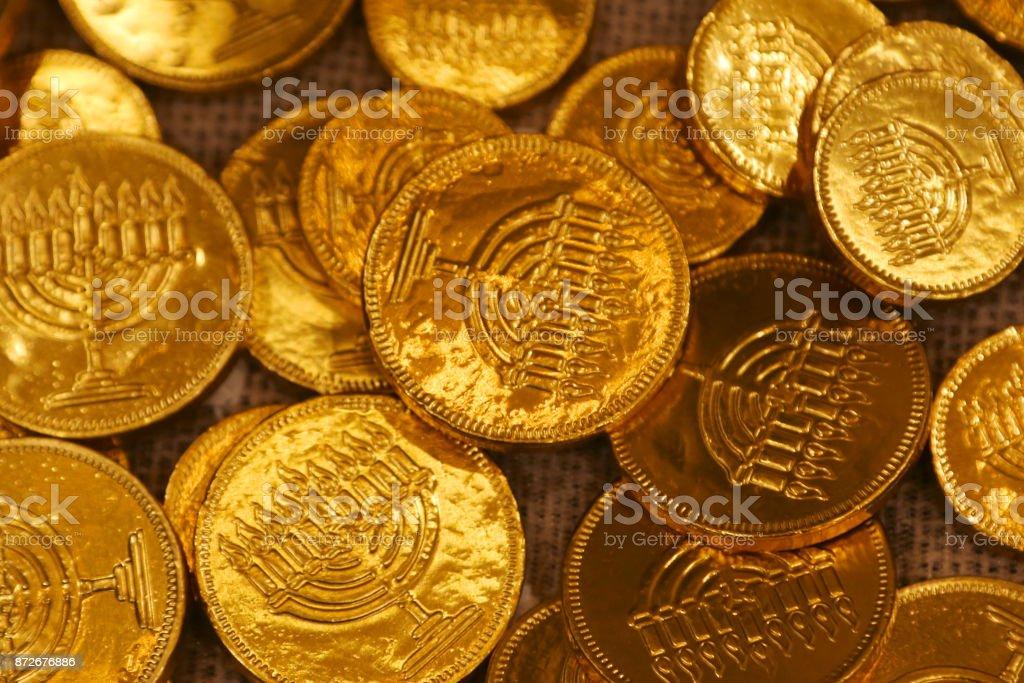 Hanukkah gelt gold coins and dreidel stock photo