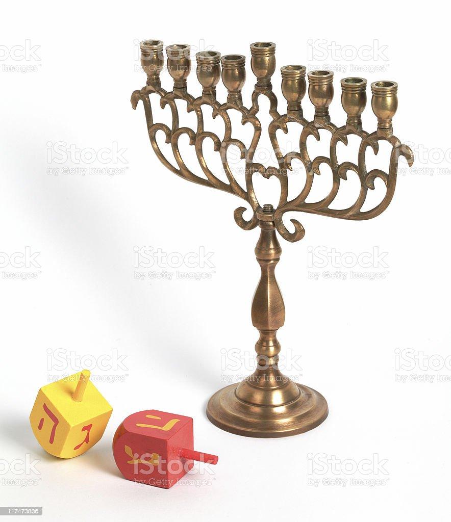 Hanukkah Menora and dreidles, isolated royalty-free stock photo