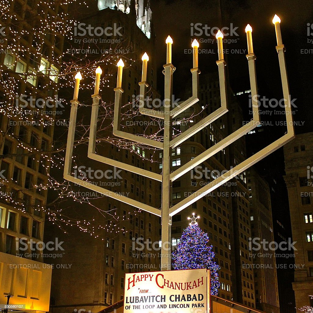 Hanukkah menorah across from Christmas tree in downtown plaza stock photo