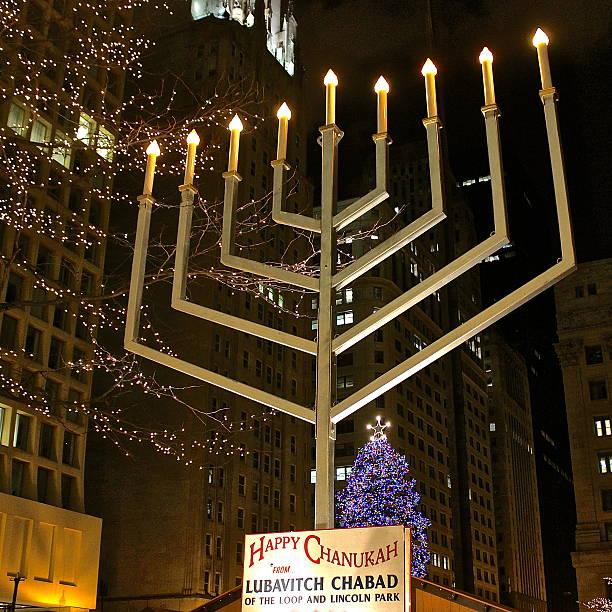 Hanukkah menorah across from Christmas tree in downtown plaza stock photo