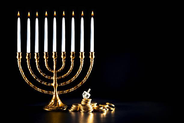 hanukkah menorah with dreidel and chocolate coins - hanukkah stock photos and pictures