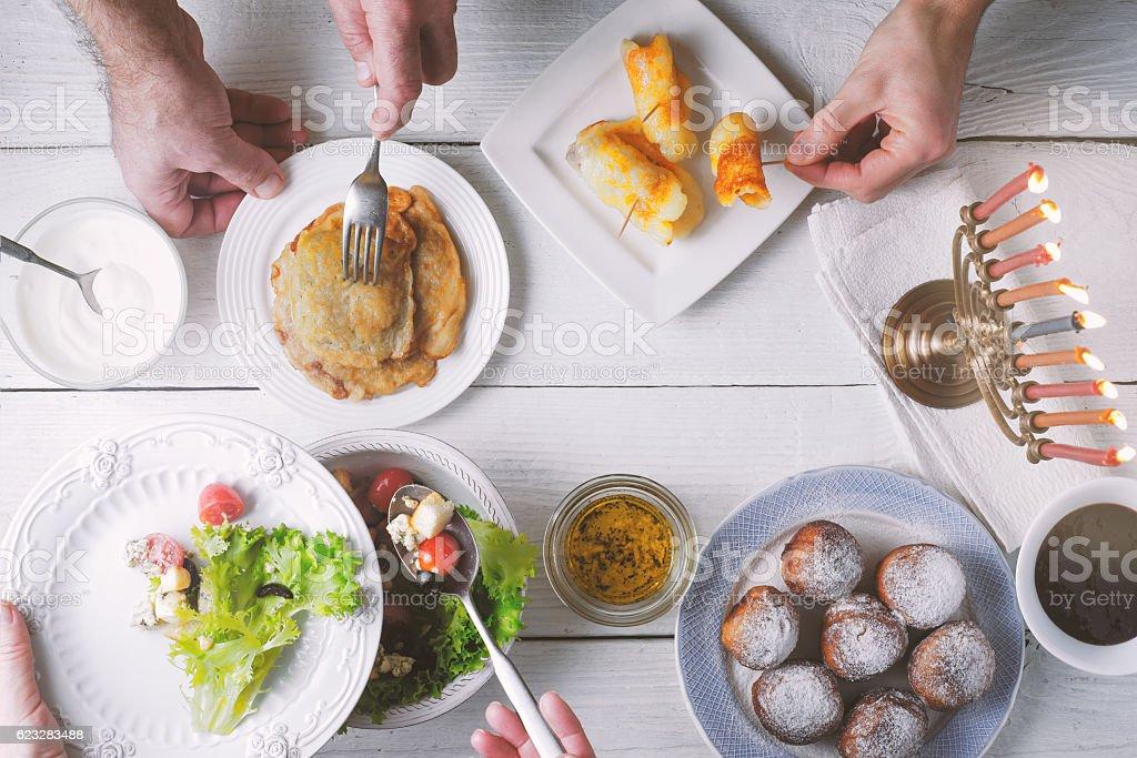 Hanukkah traditional dinner top view stock photo