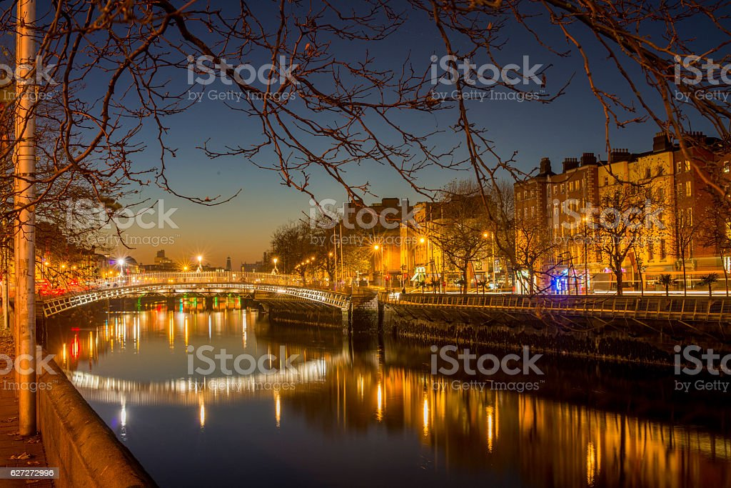 Ha'penny Bridge Dublin at dusk over the river Liffey, Dublin, Ireland. stock photo